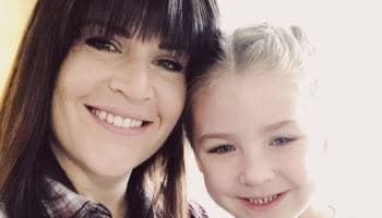 brunette with full bangs is mom and daughter selfie