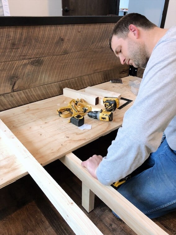 woodworking using drill to build a custom modern industrial bedframe