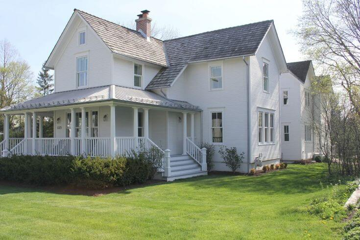 traditional 1875 white farmhouse with wrap around porch