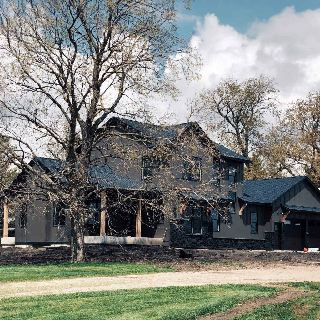 dark modern farmhouse two story custom home down leahs lane