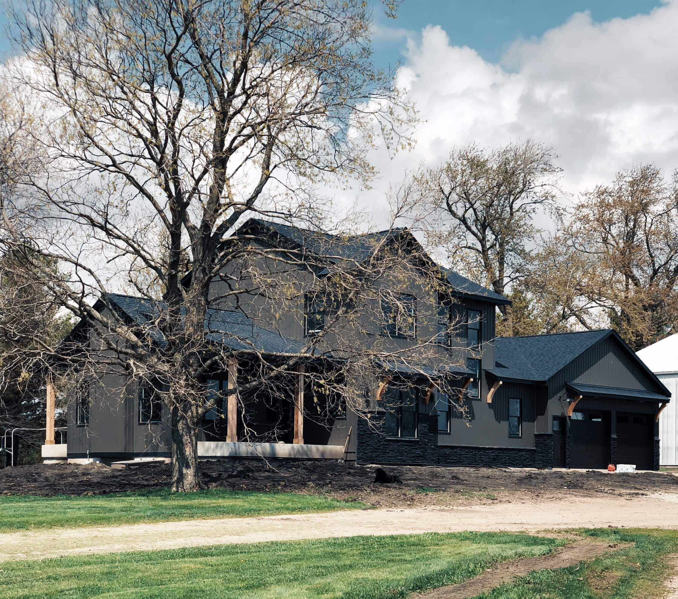 dark modern farmhouse two story custom home down leahs lane