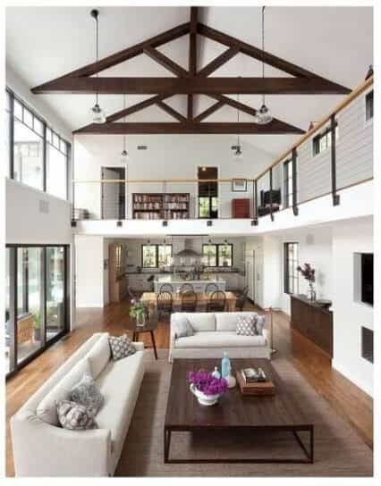 Open concept floor plan modern farmhouse with vaulted ceiling and balcony walkway