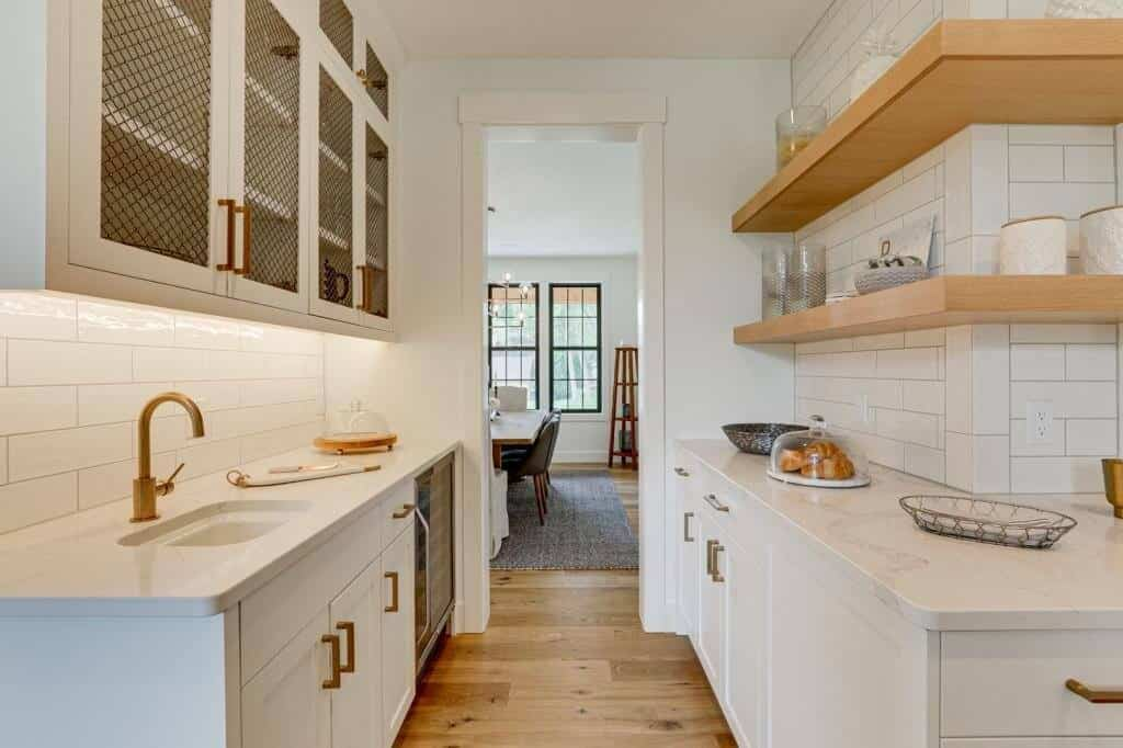 white cabinet butlers pantry with white oak flooring open shelving