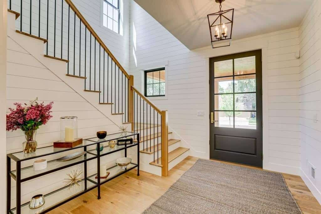 entryway foyer ideas with shiplap walls and wood flooring and glass door