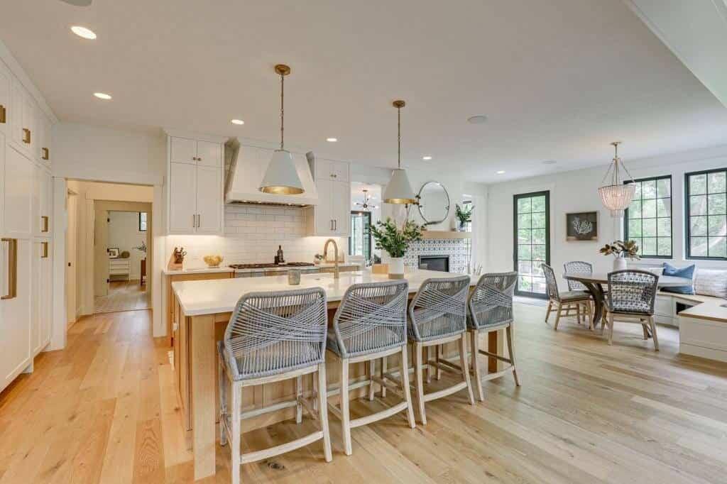 white kitchen with island and brass hardware white oak flooring