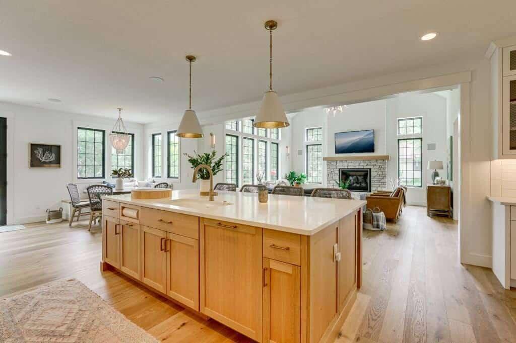 white oak kitchen island white quartz countertop open concept to living room