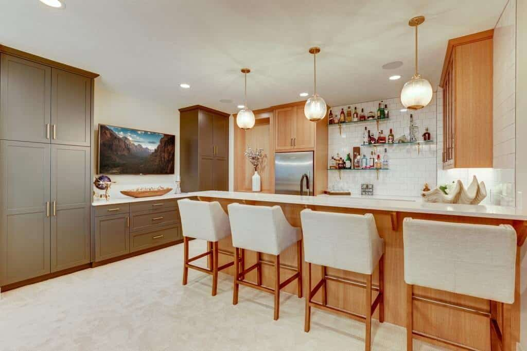 lower level basement kitchen and bar with appliances white oak cabinets