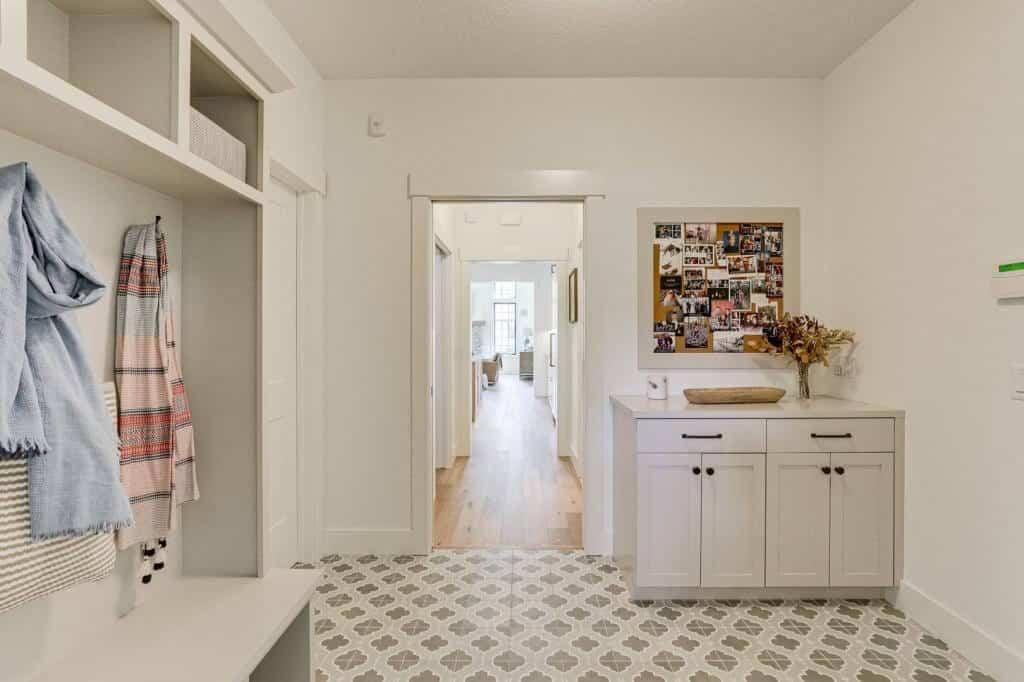 white mudroom tile floor dropzone