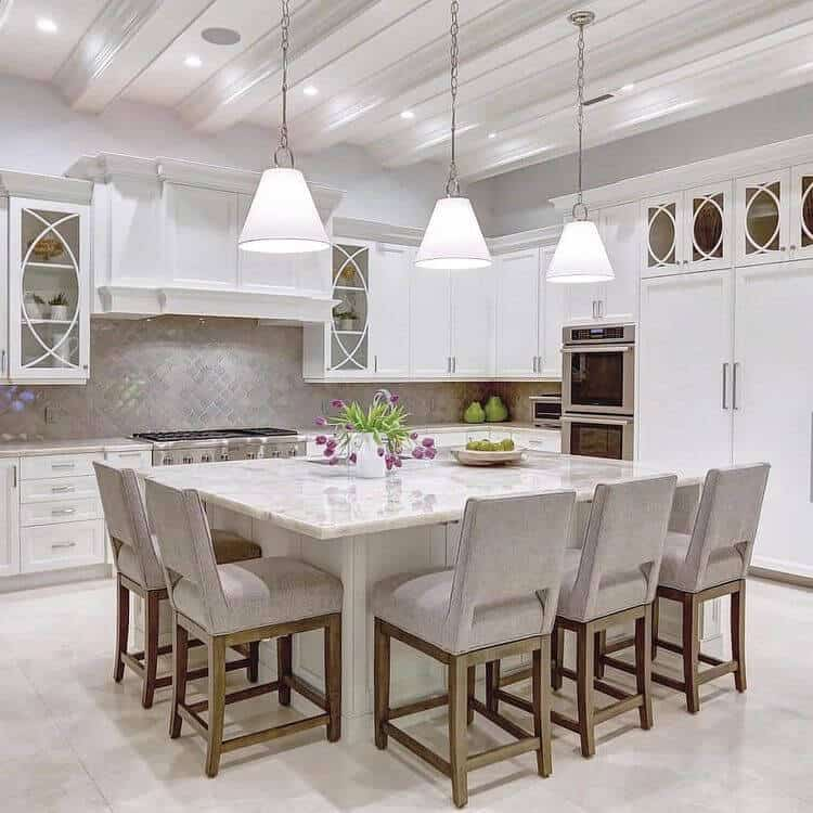 traditional classic white kitchen with white cabinets white tile flooring large white island luxury tile