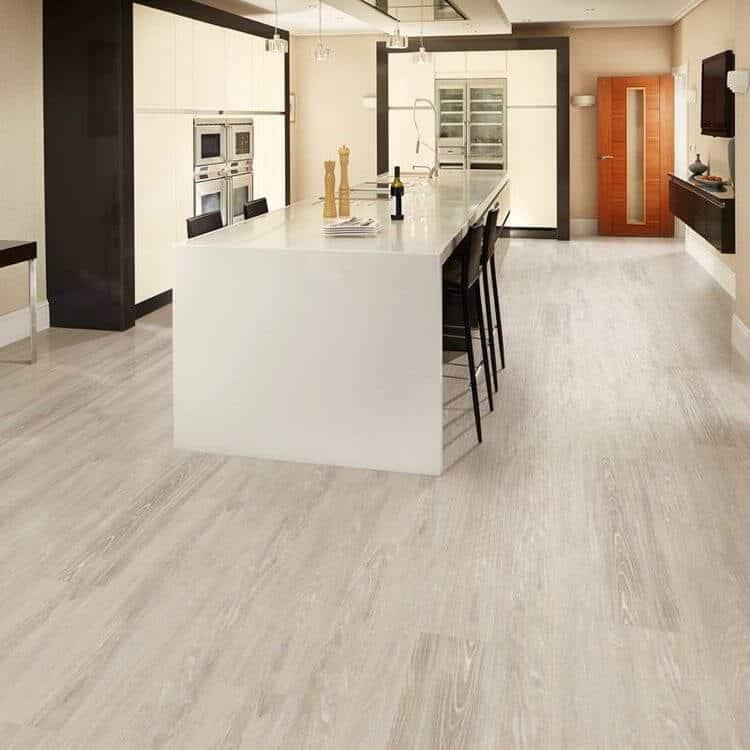 light natural wood flooring modern white kitchen waterfall island