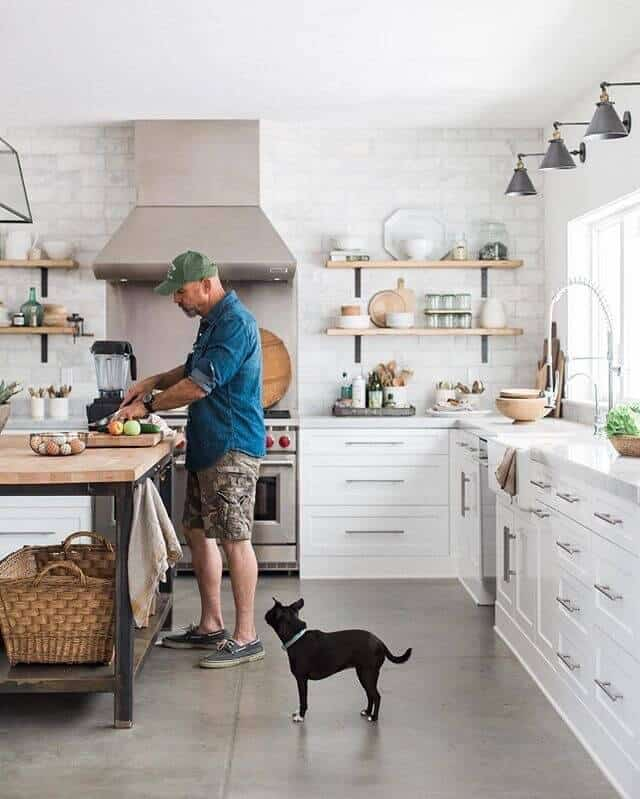 concrete cement flooring subway tile wall white kitchen cabinets industrial butcher block island