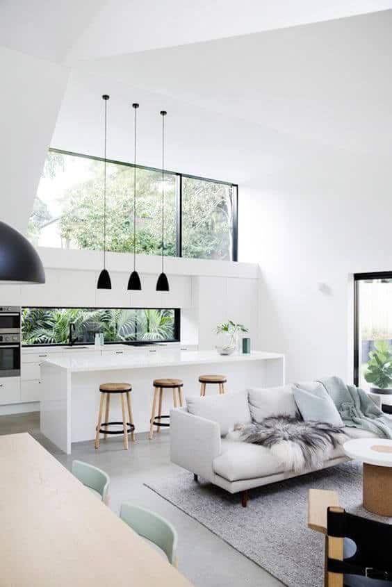 modern all white kitchen with concrete cement tile flooring