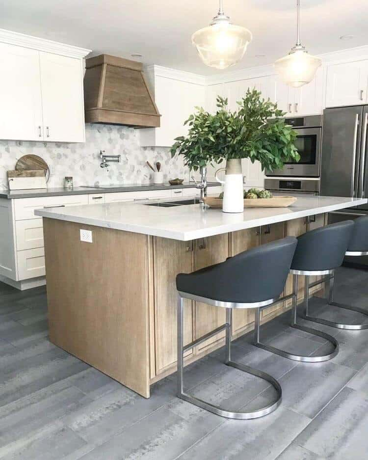 grey gray plank flooring in modern farmhouse white kitchen with natural wood hood and island with hexagon tile backsplash