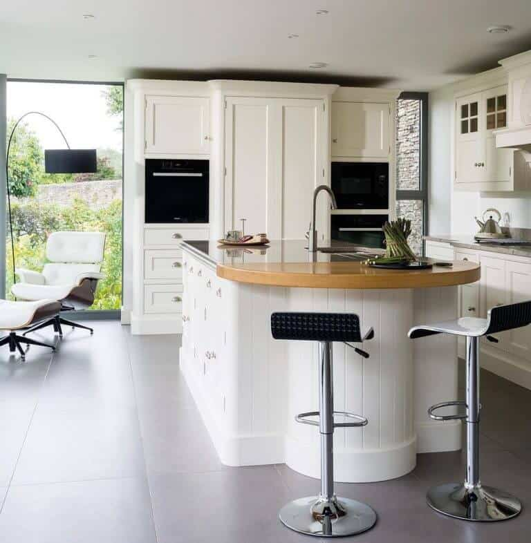 white modern traditional kitchen with large concrete cement looking tile flooring