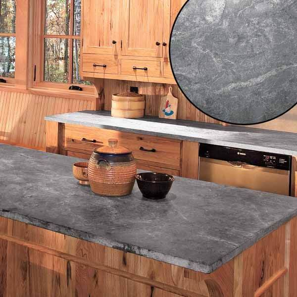 unoiled gray soapstone countertop in rustic kitchen