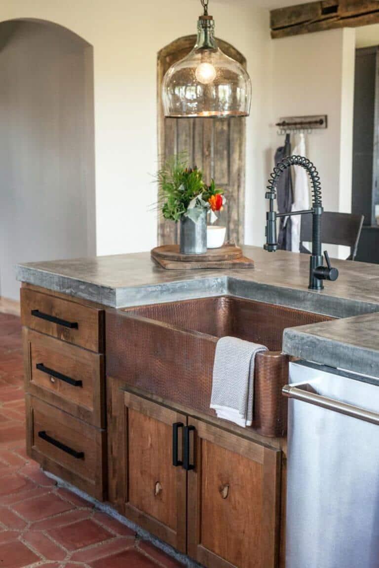 Concrete Countertop in rustic farmhouse with copper sink fixer upper joanna gaines