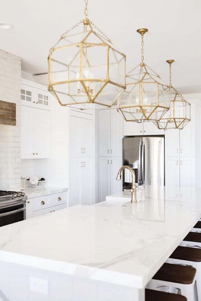Neolith Porcelain countertop in all white modern farmhouse kitchen via The Stone Shop
