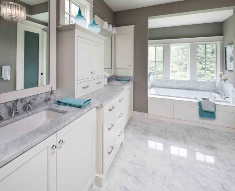 White Carrara Marble countertop, floor and backsplash in luxury master suite bathroom