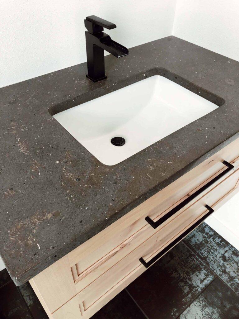 Valencia Limestone matte countertop Down Leahs Lane half bath floating vanity on natural alder with matte black faucet