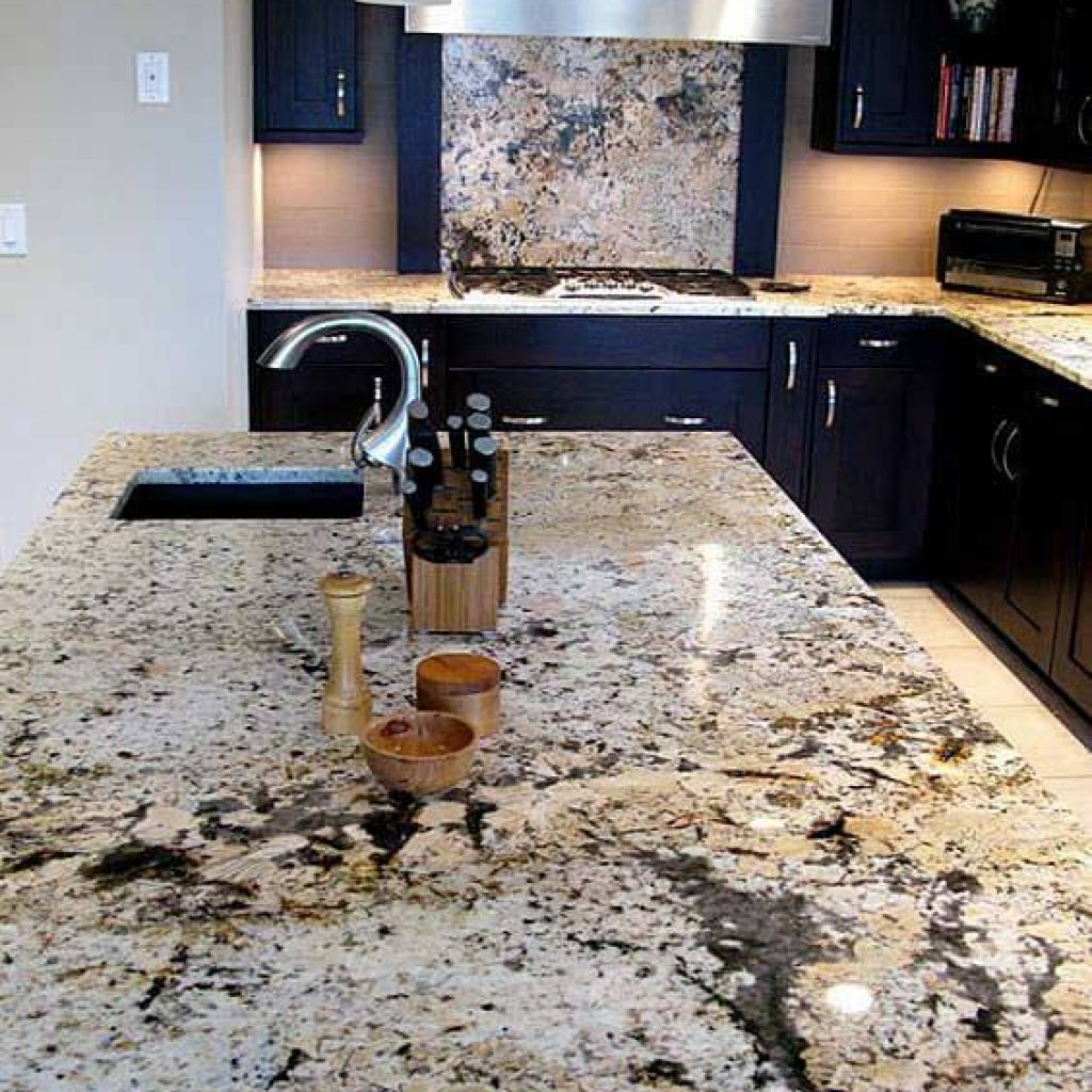 Delicatus White granite is a true statement piece in this kitchen design. With blacks, browns, tans and whites, this countertop can be used with almost any color cabinetry for a traditional to modern style kitchen.