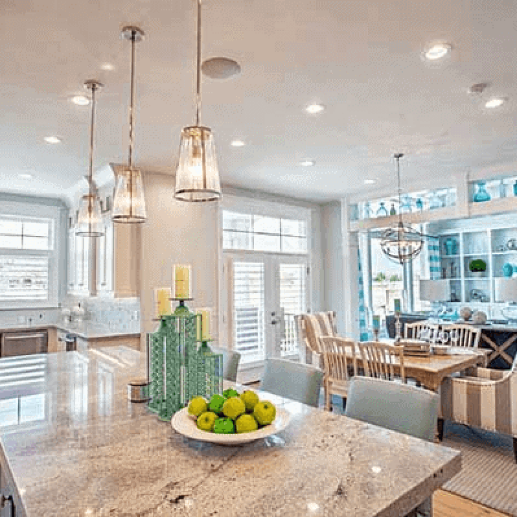 Himalayan White granite countertops give such a classy traditional feel to this stunning kitchen design. Using a grey and white base countertop allows the designer to use pops of color anytime and gives unlimited design options.
