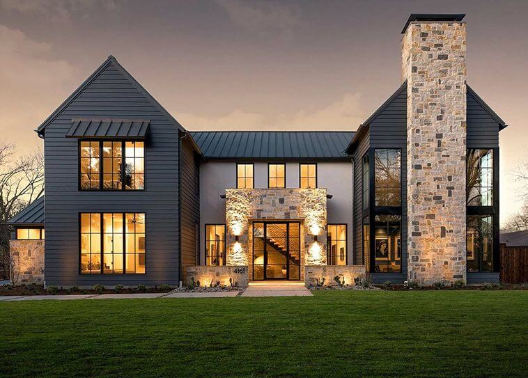 A modern Italian dark farmhouse provides stunning architecture and design ideas. The dark exterior paired with lighter stone showcases the modern lines and windows perfectly. Via John Lively + Associates and Hayes Signature Homes. #downleahslane #modernfarmhouse #italianhouse #modernexterior #darkexterior #darkhouse #blackhouse #blackexterior #modernarchitecture #stoneaccents #dreamhouse #dreamhome #luxuryhouse #luxuryhome